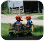 Three cousins in a wagon.